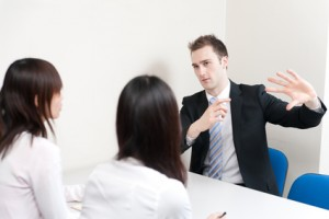 a young businessman talking to women